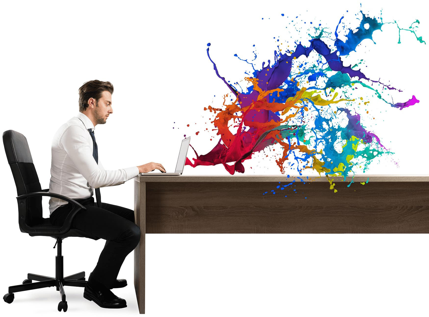Man using a computer at a desk with colors emanating from the screen